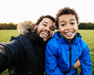 man and son with braces