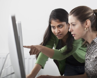 Two women reviewing a computer screen